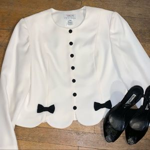 White jacket with black bow and button details